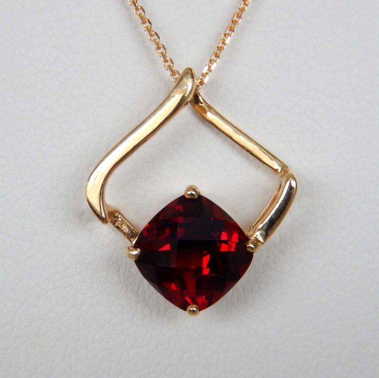 yellow gold garnet pendant