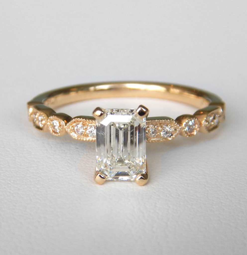 diamond accented emerald engagement ring