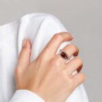 rose gold garnet and diamond fashion ring on finger