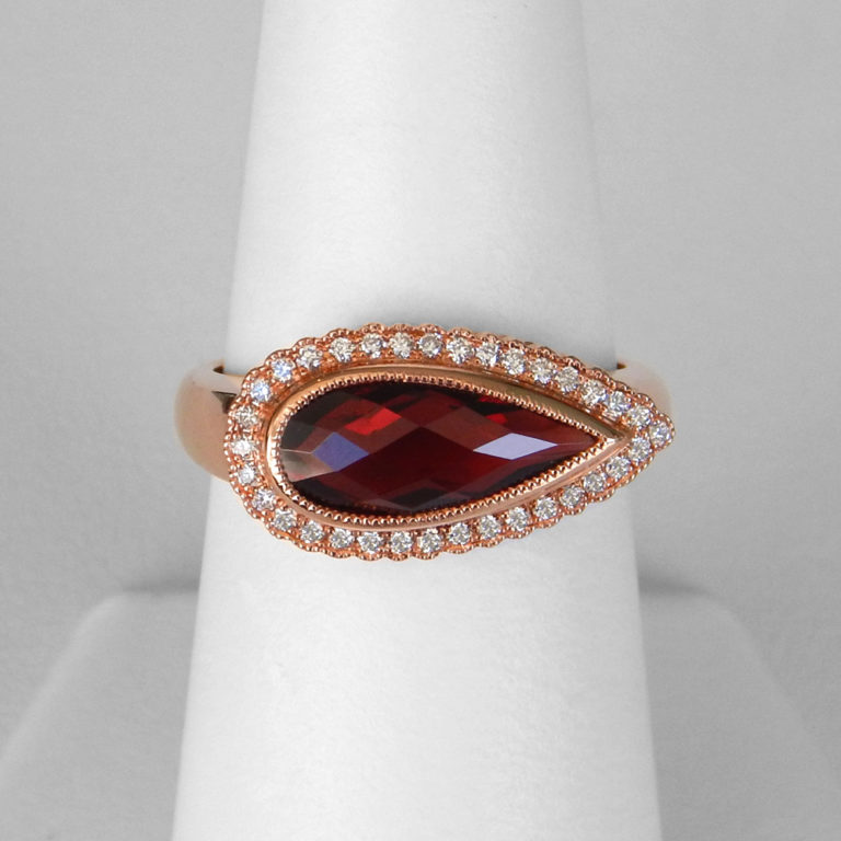 rose gold pear shaped garnet and diamond halo ring
