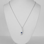 contemporary sapphire and diamond pendant on white gold chain
