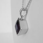 side view of white gold amethyst and diamond pendant