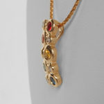 side view of yellow gold multicolored sapphire and diamond cluster pendant