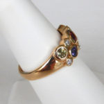 side view of yellow gold multicolored sapphire and diamond ring