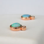 side view of rose gold opal and diamond studs