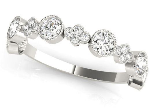 white gold bezel set diamond band with milgrain edges