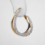 close up view of two tone gold diamond earrings