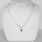 yellow gold ruby and diamond art deco pendant on chain