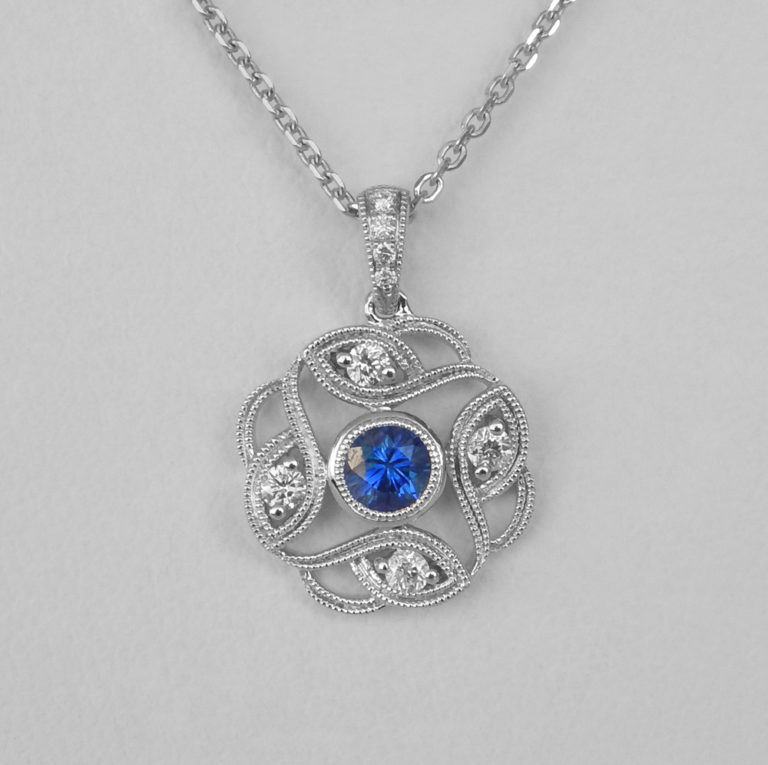white gold sapphire and diamond scroll pendant
