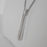 side view of sterling silver diamond line pendant