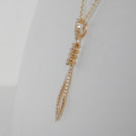 side view of yellow gold diamond pendant