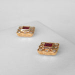 side view of yellow gold ruby and diamond earrings