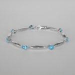 sterling silver blue topaz and diamond bracelet
