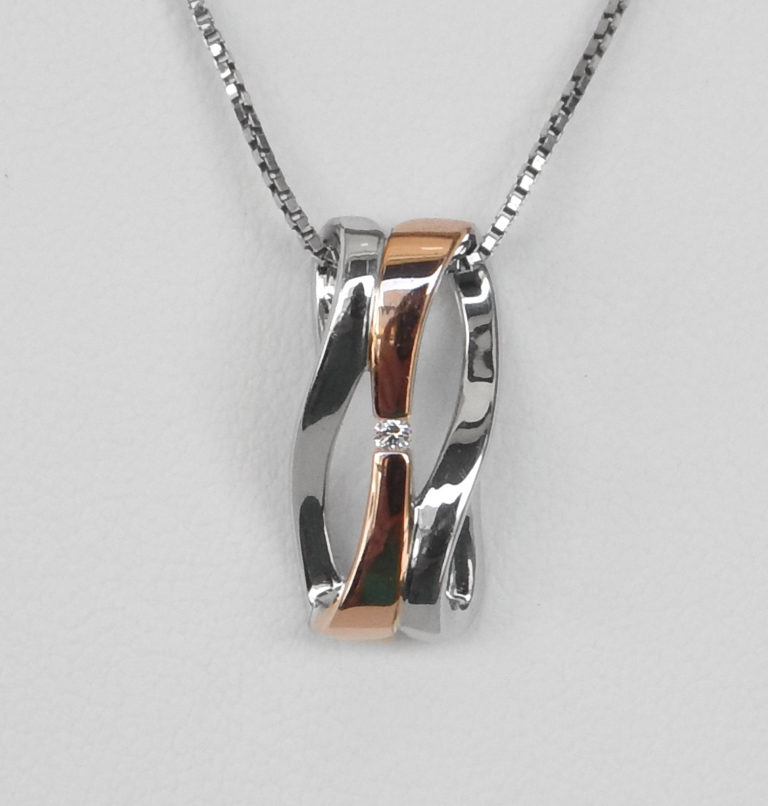 two tone silver and rose gold diamond pendant