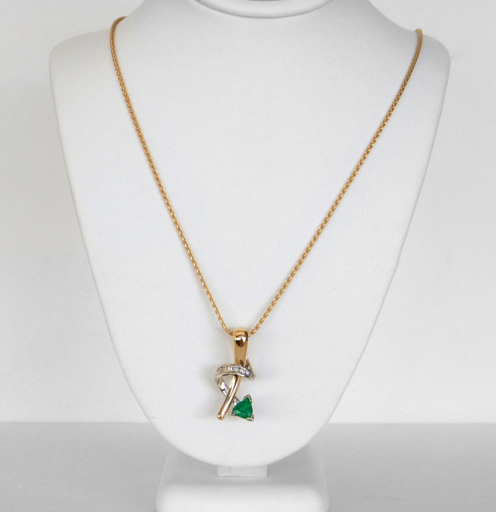 yellow gold contemporary style emerald and diamond pendant