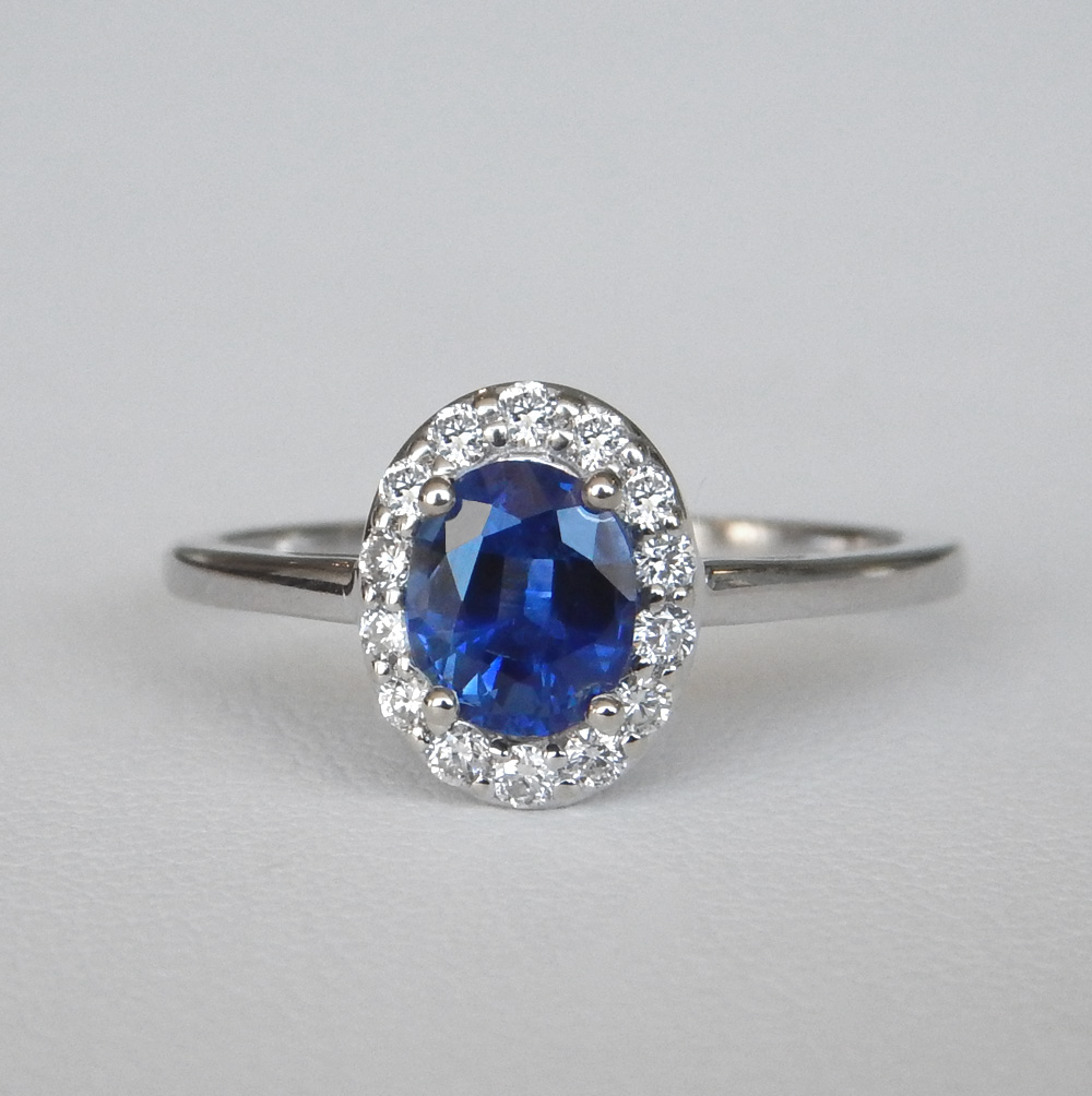 white gold oval sapphire and diamond halo ring