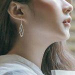 sterling silver twisted drop earrings on model