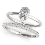 white gold oval diamond engagement ring with matching diamond band
