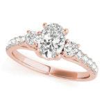 rose gold three stone diamond engagement ring