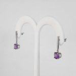 side view of white gold amethyst dangle earrings