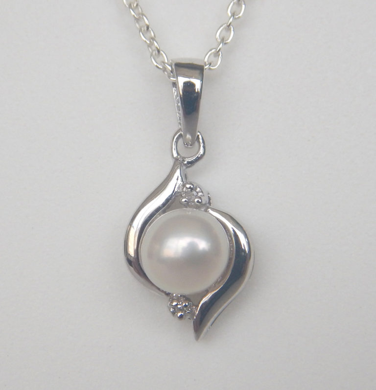 sterling silver pearl and diamond pendant