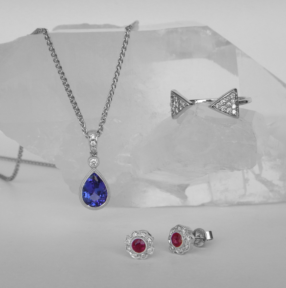 tanzanite pendant, diamond ring, and ruby earrings