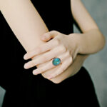 large sterling silver turquoise ring on finger