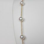 close up view of tin cup pearl necklace