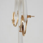 side view of yellow gold diamond earrings