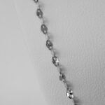 close up view of white gold necklace chain