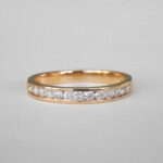 yellow gold channel set diamond band