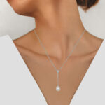 white gold pearl and diamond necklace on model