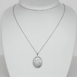 sterling silver oval engraved locket on chain
