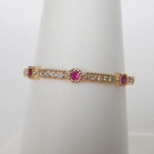 yellow gold ruby and diamond band