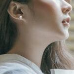 white gold 7mm akoya pearl stud on model