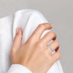 large white gold diamond band on finger