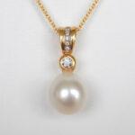 yellow gold pearl and diamond pendant