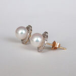 side view of two tone gold pearl and diamond earrings