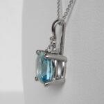 side view of white gold aquamarine and diamond pendant
