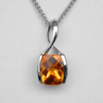 close up view of white gold citrine pendant