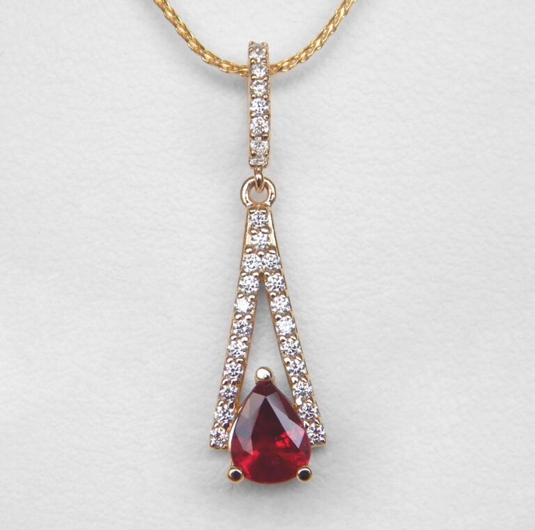 yellow gold pear shape ruby and diamond pendant