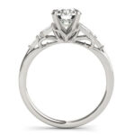 side view of white gold baguette accented diamond engagement ring