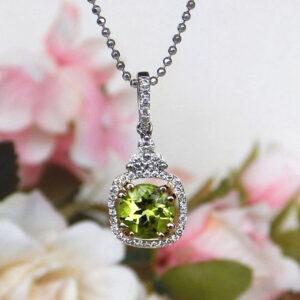 white gold peridot and diamond pendant