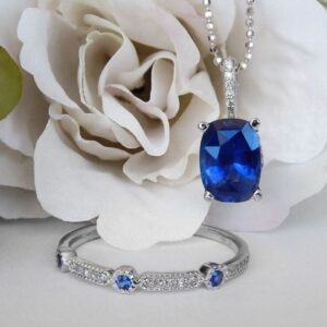 white gold sapphire and diamond band and sapphire pendant