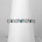 white gold emerald and diamond scalloped band with milgrain edges