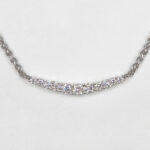 close up view of white gold graduated diamond necklace